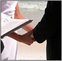 Picture of man and woman holding hands in committment ceremony